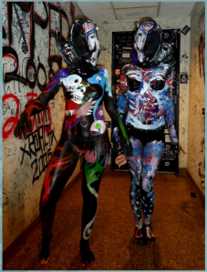 Image courtesy of The Red Paintings website. Human canvases pose after a show with their delightful body art.